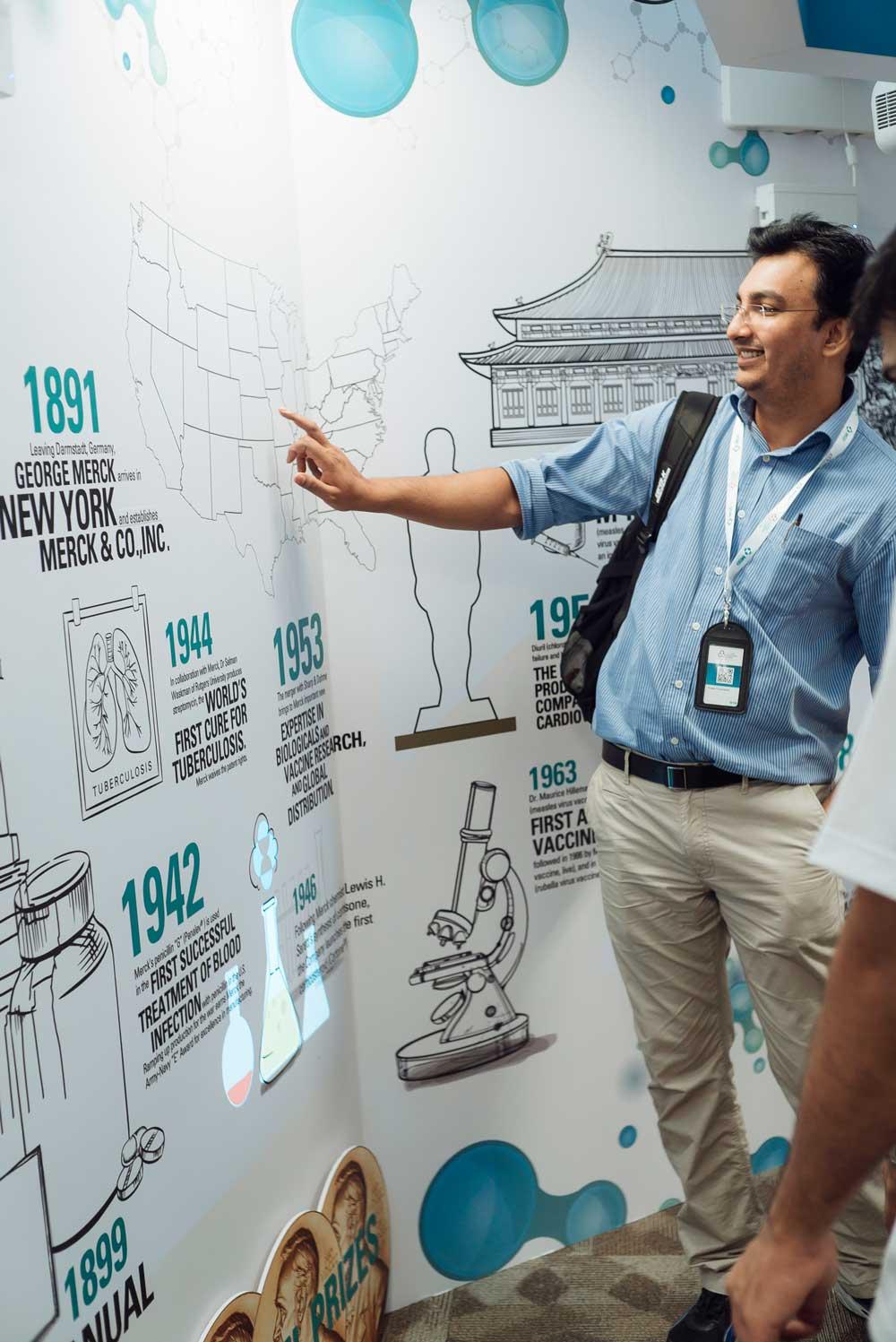 men smiling at using an interactive wall