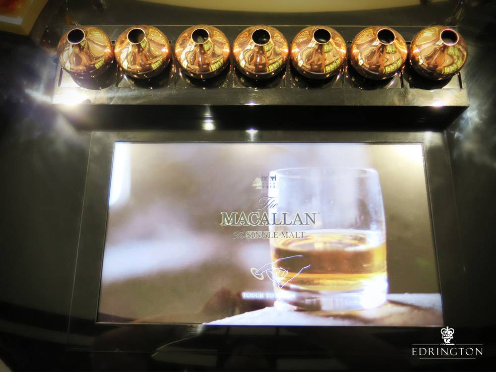 interactive screen with macallan glass of whiskey