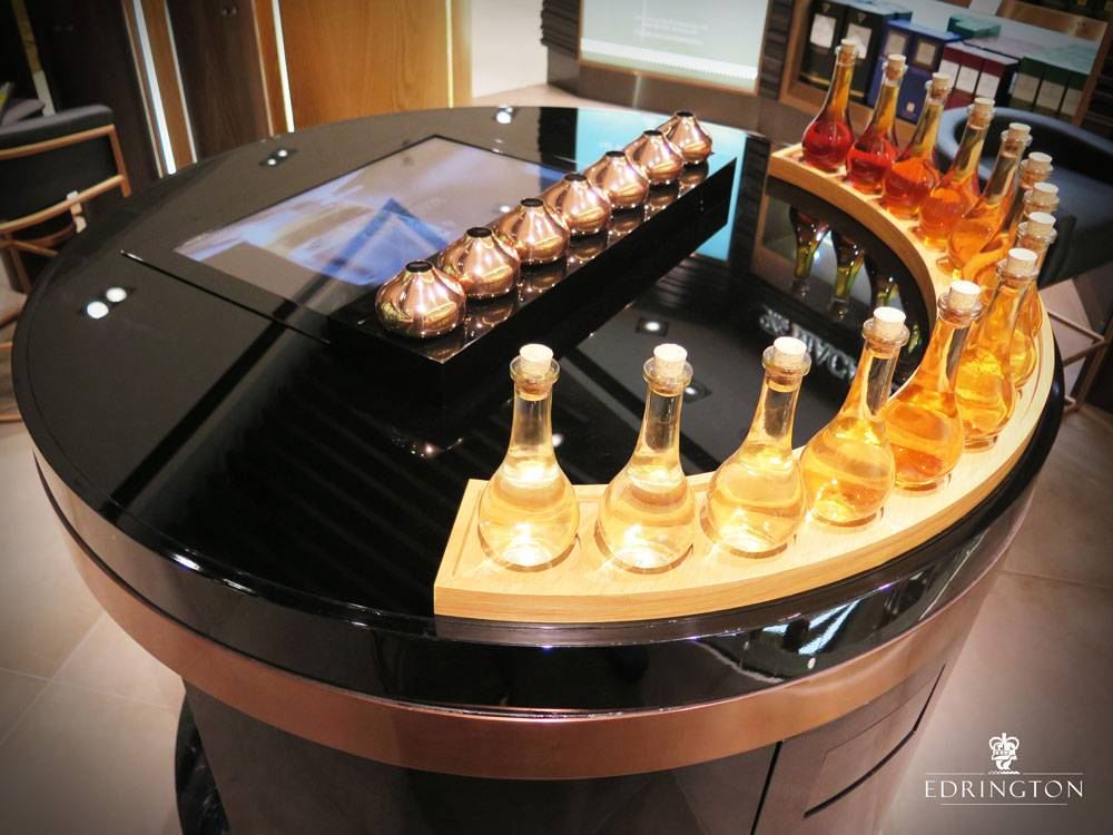 Interactive RFID table with bottles of alcohol