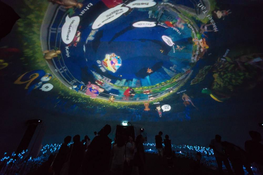 peoples enjoying in a projection dome