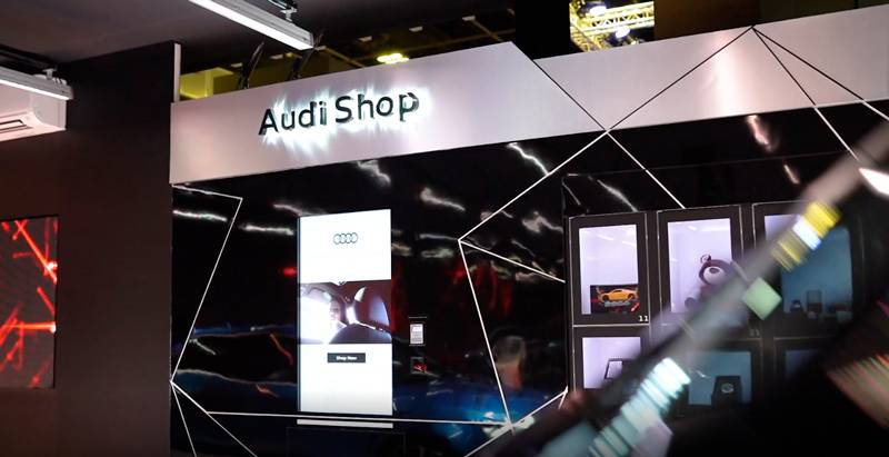 Audi booth in a trade show with interactive screen